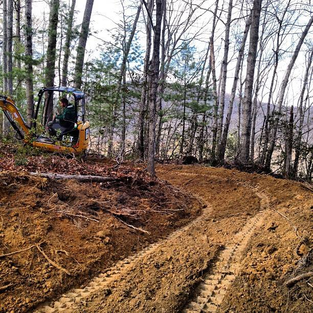 Overlooking the North River at the Stokesville Lodge and Campground with Andrew Mueller of Elevated Trail Design groom some new singletrack.